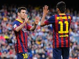 Neymar of FC Barcelona celebrates with his team-mate Lionel Messi of FC Barcelona during the La Liga match between FC Barcelona and Real Betis Balompie at Camp Nou on April 5, 2014
