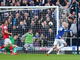 Steven Naismith of Everton celebrates scoring the first goal during the Barclays Premier League match between Everton and Arsenal at Goodison Park on April 6, 2014