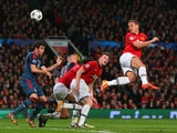 Nemanja Vidic of Manchester United heads in the first goal during the UEFA Champions League Quarter Final first leg match against Bayern Munich on April 1, 2014
