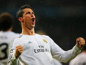 Cristiano Ronaldo of Real Madrid celebrates scoring his goal during the UEFA Champions League Quarter Final first leg match between Real Madrid and Borussia Dortmund at Estadio Santiago Bernabeu on April 2, 2014