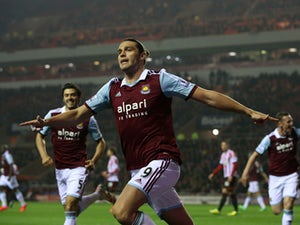 Andy Carroll of West Ham celebrates after scoring the opening goal during the Barclays Premier League match between Sunderland and West Ham United at the Stadium of Light on March 31, 2014