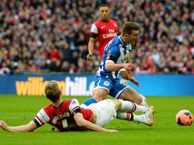 Per Mertesacker of Arsenal fouls Callum McManaman of Wigan Athletic in the penalty area during the FA Cup semi-final at Wembley on April 12, 2014