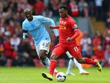 Liverpool's Daniel Sturridge and Manchester City's Yaya Toure in action during the Premier League match on April 13, 2014
