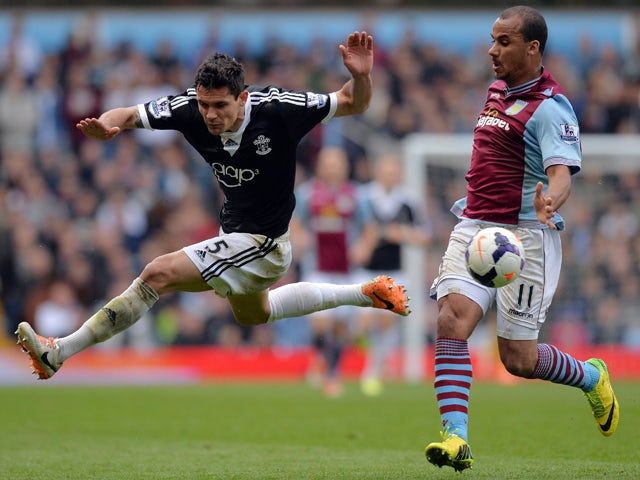 Aston Villa's English striker Gabriel Agbonlahor and Southampton's Croatian defender Dejan Lovren compete for the ball during the English Premier League football match between Aston Villa and Southampton at Villa Park in Birmingham on April 19, 2014