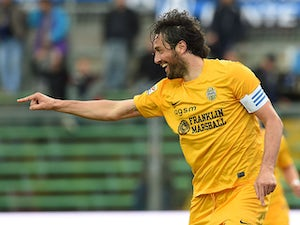 Hellas Verona's Luca Toni celebrates after scoring his team's second goal against Atalanta during the Serie A match on April 19, 2014