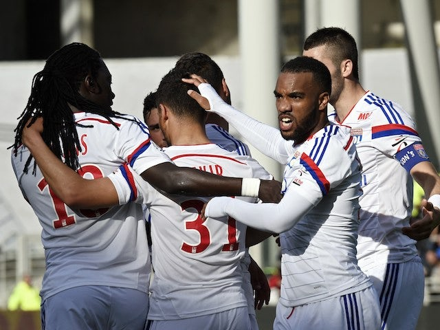 Lyon's French forward Alexandre Lacazette (R) celebrates with teammates after scoring during the French Ligue 1 football match against SC Bastia on April 27, 2014