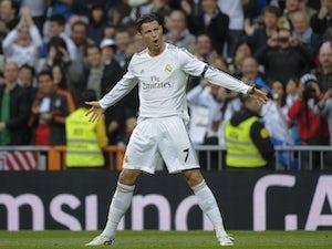 Real Madrid's Portuguese forward Cristiano Ronaldo celebrates after scoring during the Spanish league football match Real Madrid CF vs CA Osasuna on April 26, 2014