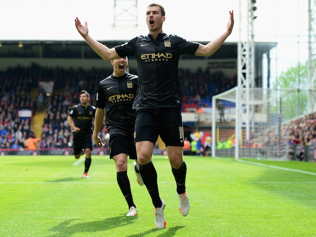 Edin Dzeko of Manchester City celebrates scoring the opening goal with Samir Nasri of Manchester City during the Barclays Premier League match against Crystal Palace on April 27, 2014