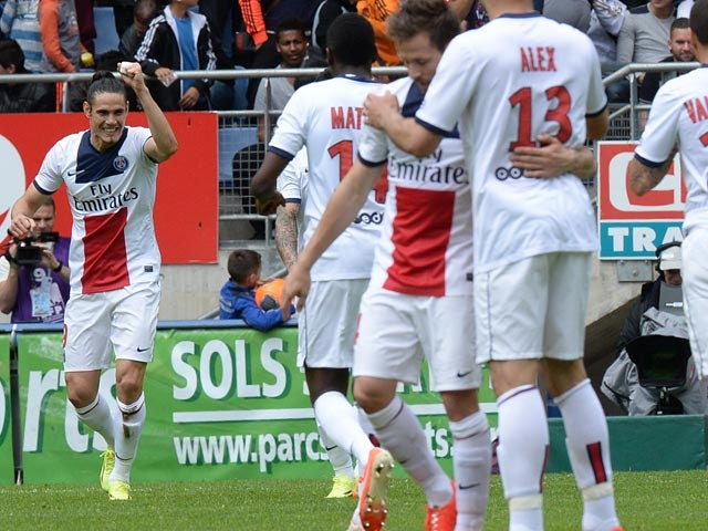 PSG's Edinson Cavani celebrates with teammates after scoring the opening goal against Sochaux during the Ligue 1 match on April 27, 2014