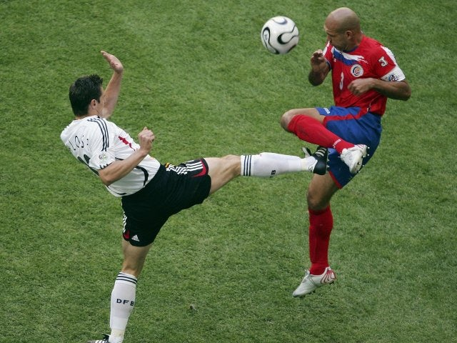 Costa Rica captain Luis Martin battles for possession with Germany striker Miroslav Klose on June 09, 2006.