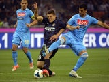Inter Milan's Croatian midfielder Mateo Kovacic (L) fights for the ball with Napoli's Uruguayan defender Angel Miguel Britos during the Italian Seria A football match on April 26, 2014
