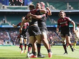 Saracens' Owen Farrell celebrates with teammates after scoring his team's third try against Clermont Auvergne during the Heineken Cup semi-final match on April 26, 2014
