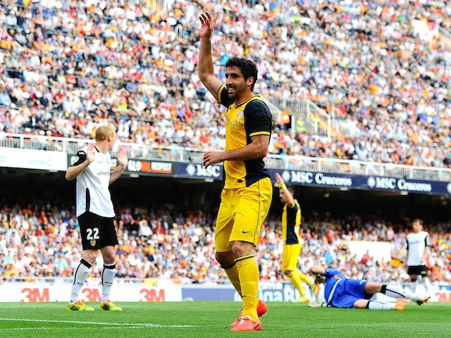 Raul Garcia of Club Atletico de Madrid celebrates after scoring the opening goal during the La Liga match against Valencia on April 27, 2014
