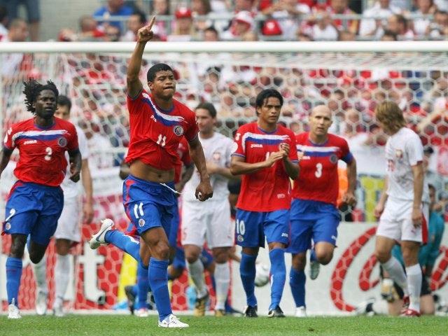 Costa Rica midfielder Roland Gomez celebrates scoring against Poland on June 20, 2006.