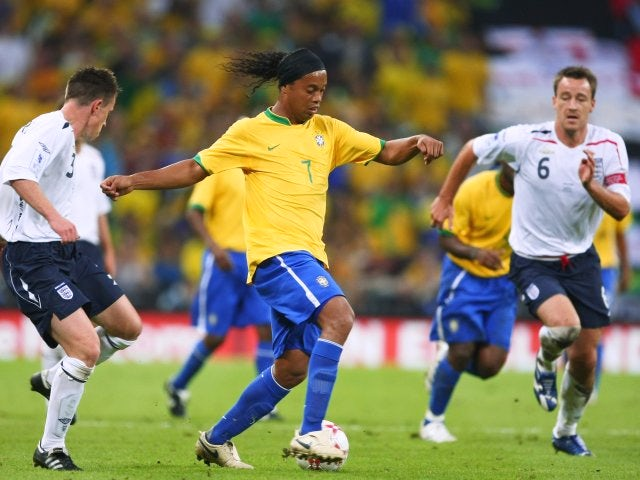Brazil's Ronaldinho keeps possession from England defenders Nicky Shorey and John Terry on June 01, 2002.