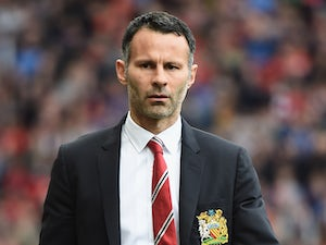 Manchester United manager Ryan Giggs walks to the dugout prior to kick-off against Norwich in the Premier League match on April 26, 2014