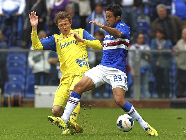 Eder Citadin Martins of UC Sampdoria competes for the ball with Nicolas Frey of AC Chievo Verona during the Serie A match between UC Sampdoria and AC Chievo Verona at Stadio Luigi Ferraris on April 27, 2014