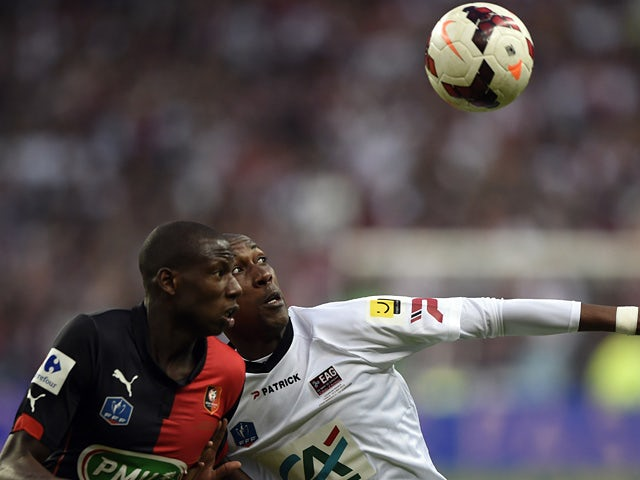 Rennes' Abdoulaye Doucoure and Guingamp's Steeven Langil in action during the French Cup final on May 3, 2014