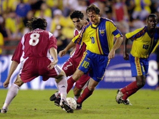 Ecuador captain Alex Aguinaga dribbles with the ball on June 22, 2002.