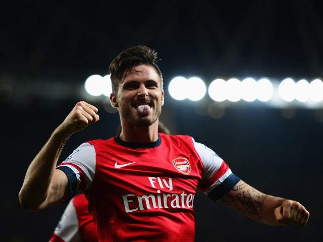 Olivier Giroud of Arsenal celebrates as he scores their third goal during the Barclays Premier League match between Arsenal and Newcastle United at Emirates Stadium on April 28, 2014