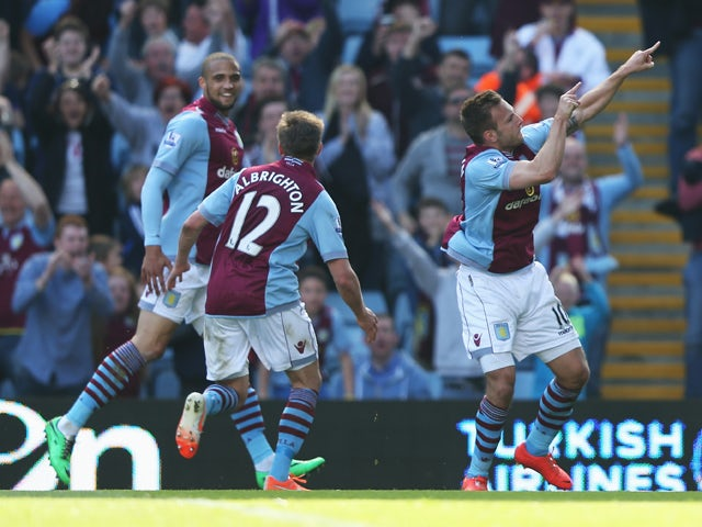 Andreas Weimann of Aston Villa celebrates his second goal during the Barclays Premier League match between Aston Villa and Hull City at Villa Park on May 3, 2014