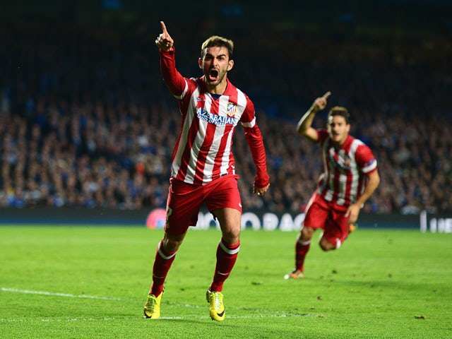 Adrian Lopez of Club Atletico de Madrid celebrates scoring his goal during the UEFA Champions League semi-final second leg match between Chelsea and Club Atletico de Madrid at Stamford Bridge on April 30, 2014