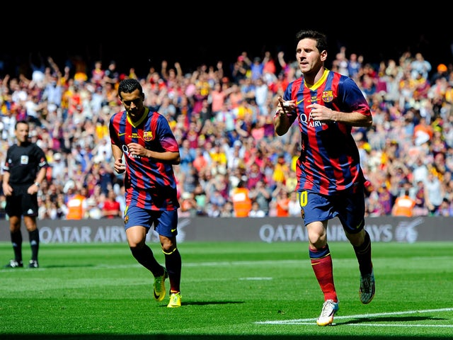 Lionel Messi of FC Barcelona celebrates after scoring the opening goal during the La Liga match between FC Barcelona and Getafe CF at Nou Camp on May 3, 2014