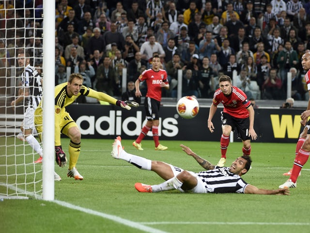 Benfica's Slovenian goalkeeper Jan Oblak and teammates eye the ball as Juventus' Argentinian foward Carlos Tevez tries to score during the UEFA Europa League semifinal football match Juventus vs Benfica on May 1st, 2014