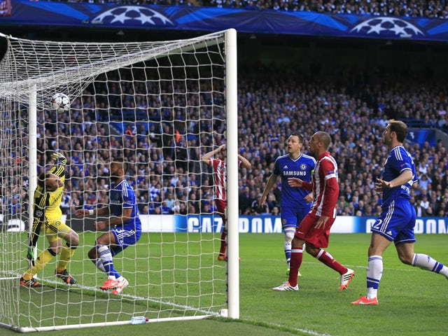 Caption:The ball lands on Chelsea's net after a corner from Atletico Madrid during the UEFA Champions League semi-final second leg football match between Chelsea and Atletico Madrid at Stamford Bridge in London on April 30, 2014