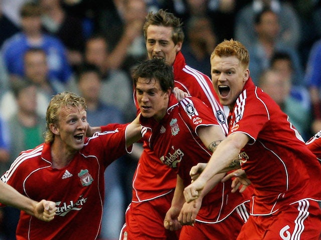 Daniel Agger of Liverpool is mobbed by team mates after scoring the first goal of the game during the UEFA Champions League semi final second leg match against Chelsea on May 1, 2007