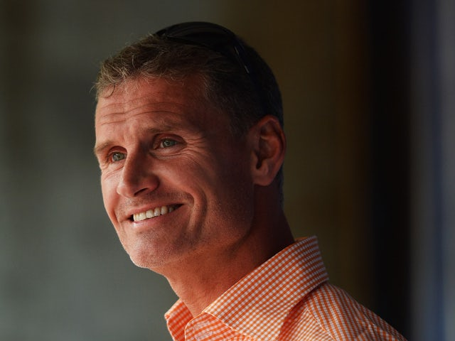 Former F1 driver David Coulthard talks to fans at a campsite appearance following qualifying for the British Formula One Grand Prix at Silverstone Circuit on June 29, 2013