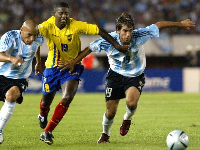 Ecuador's Edison Mendez battles for possession against Argentina on March 30, 2004.