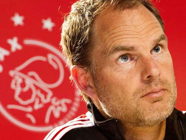 Ajax Amsterdam head coach Frank de Boer attends a press conference after the training session in Amsterdam, on April 11, 2014