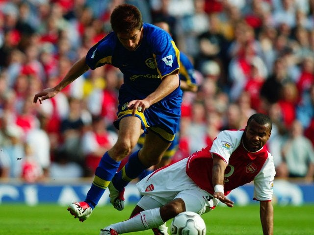 Harry Kewell, then of Leeds United, skips away from Arsenal full-back Ashley Cole on May 04, 2003.