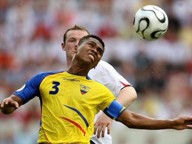 Ecuador defender Ivan Hurtado jumps for the ball against England striker Wayne Rooney on June 25, 2006.