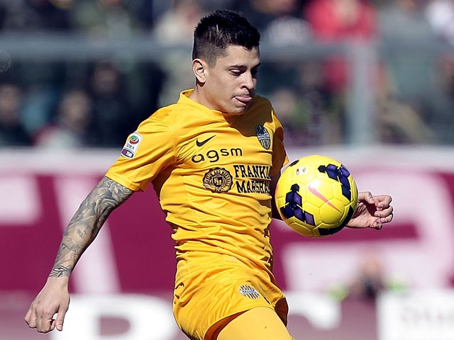 Juan Iturbe of Hellas Verona FC in action during the Serie A match between AS Livorno Calcio and Hellas Verona FC at Stadio Armando Picchi on February 23, 2014