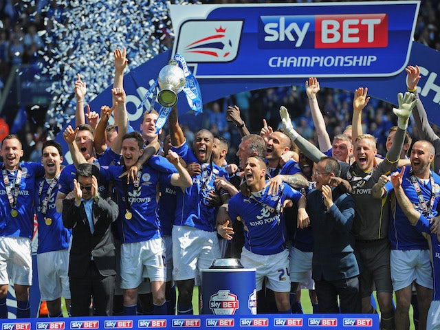 Leicester City player with the Championship trophy on May 3, 2014