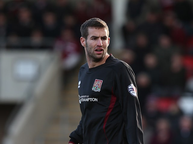 Matty Blair of Northampton Town in action during the Sky Bet League Two match between Cheltenham Town and Northampton Town at The Abbey Business Stadium on February 1, 2014