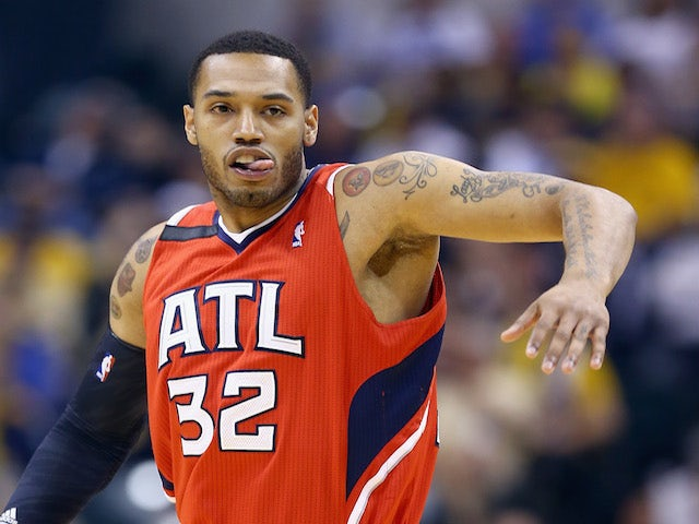 Mike Scott of the Atlanta Hawks celebrates after making a three point shot against the Indiana Pacers in Game 5 of the Eastern Conference Quarterfinals on April 28, 2014
