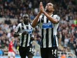 Newcastle United's French striker Loic Remy celebrates scoring his team's second goal during the English Premier League football match between Newcastle United and Cardiff City at St James' Park in Newcastle-upon-Tyne, northeast England, on May 3, 2014