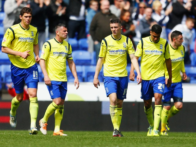 Nikola Zigic, Paul Robinson, Callum Reilly and Tom Adeyemi of Birmingham City look dejected after a goal from Bolton Wanderers on May 3, 2014