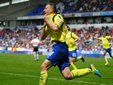 Paul Caddis of Birmingham City celebrates as he scores their second goal with a header to equalise during the Sky Bet Championship match against Bolton Wanderers on May 3, 2014