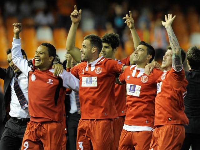 Sevilla's players celebrate at the end of the UEFA Europa League semi-final second leg football match Valencia CF vs FC Sevilla at the Mestalla stadium in Valencia on May 1, 2014