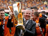 Wolves manager Kenny Jackett lifts the Sky Bet League One trophy during the Sky Bet League One match between Wolverhampton Wanderers and Carlisle United at Molineux on May 3, 2014