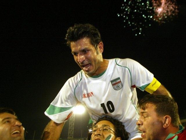 Iran striker Ali Daei is held aloft by supporters on June 08, 2005.