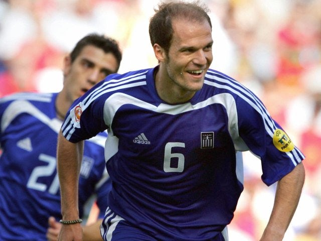 Angelos Basinas celebrates scoring for Greece at the European Championships on June 12, 2004.