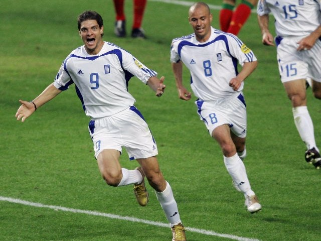 Greece striker Angelos Charisteas celebrates scoring during the European Championships final on July 04, 2004.