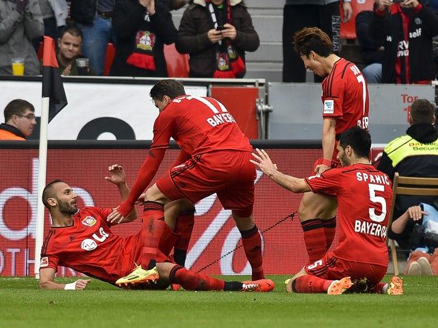 Leverkusen's Turkish defender Omer Toprak celebrates scoring with his teammates during the German first division Bundesliga football match Bayer 04 Leverkusen vs SV Werder Bremen, in Leverkusen, western Germany on May 10, 2014