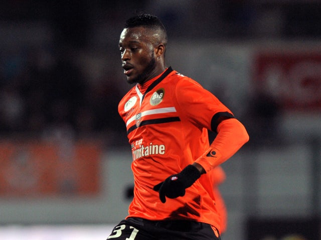 Lorient's French midfielder Cheick Doukoure controls the ball during the French L1 football match Lorient against Nice on November 30, 2013