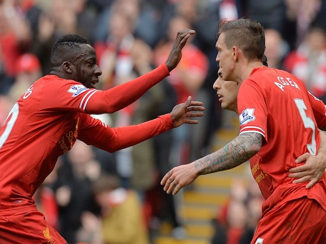 Liverpool's Danish defender Daniel Agger (Foreground R) celebrates with Liverpool's Uruguayan striker Luis Suarez (2nd R) and Liverpool's French defender Aly Cissokho on May 11, 2014